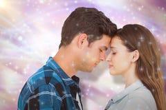 Image composée de tête debout de couples contre la tête Photographie stock libre de droits