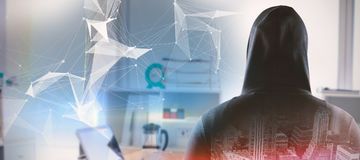Image composée de vue arrière d'espion dans le hoodie Photo libre de droits