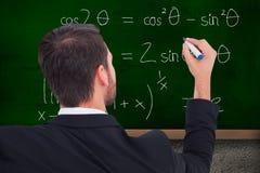Image composée de vue arrière de l'écriture d'homme d'affaires avec le marqueur Images libres de droits