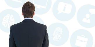 Image composée de vue arrière de la position d'homme d'affaires Image stock