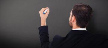 Image composée de vue arrière de l'écriture d'homme d'affaires avec le marqueur Photographie stock