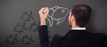Image composée de vue arrière de l'écriture d'homme d'affaires avec le marqueur Photographie stock libre de droits