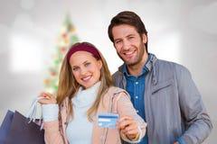 Image composée des ajouter de sourire aux paniers montrant la carte de crédit Photos stock
