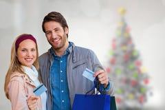 Image composée des ajouter de sourire aux paniers montrant la carte de crédit Image libre de droits