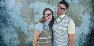 Image composée des ajouter geeky heureux de hippie aux visages idiots Photographie stock