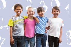 Image composée des amis heureux souriant à l'appareil-photo Photographie stock libre de droits