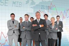 Image composée des bras debout d'équipe d'affaires croisés Images stock