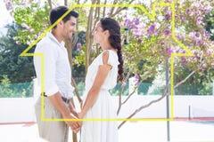Image composée des couples attrayants se tenant dans le jardin tenant des mains Images stock