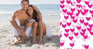 Image composée des couples de caresse souriant à l'appareil-photo Photographie stock
