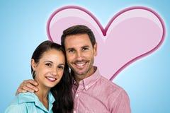 Image composée des couples de sourire regardant l'appareil-photo Photo stock