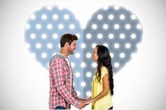 Image composée des couples de sourire tenant des mains et regardant l'un l'autre Image stock