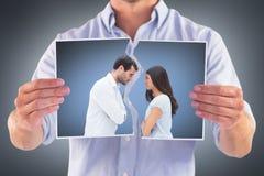 Image composée des couples fâchés faisant face après argument image libre de droits
