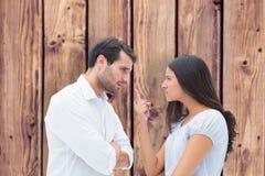 Image composée des couples fâchés faisant face pendant l'argument images libres de droits