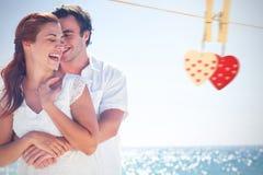 Image composée des couples heureux étreignant et riant ensemble Photos libres de droits