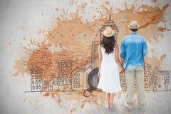 Image composée des couples heureux de hippie tenant des mains Photos libres de droits