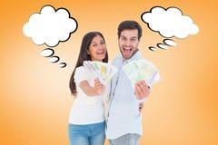 Image composée des couples heureux montrant leur argent Photos stock