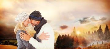 Image composée des couples mignons de sourire romancing au-dessus du fond blanc Images stock