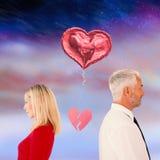 Image composée des couples ne parlant pas avec le coeur brisé entre eux Photographie stock