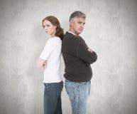 Image composée des couples occasionnels ne parlant pas après combat Photographie stock libre de droits