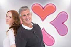 Image composée des couples occasionnels souriant à l'appareil-photo Images libres de droits