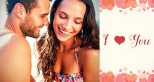 Image composée des couples sur des mots de plage et de valentines Image libre de droits