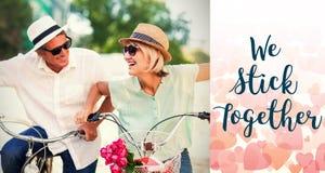 Image composée des couples sur des mots de vélo et de valentines Images libres de droits