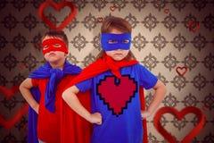 Image composée des enfants masqués feignant pour être super héros Images libres de droits