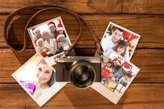 Image composée des enfants s'asseyant avec leur famille tenant des bottes de Noël Photo libre de droits