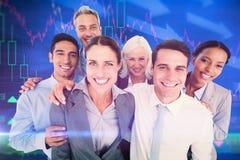 Image composée des gens d'affaires heureux regardant l'appareil-photo Photo libre de droits