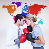 Image composée des gens d'affaires portant et enfermant dans une boîte les gants rouges image stock