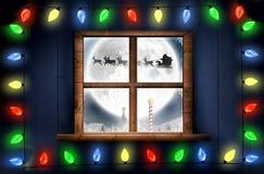 Image composée des lumières décoratives accrochant dans une forme Photos stock