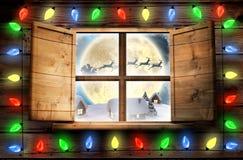 Image composée des lumières décoratives accrochant dans une forme Photographie stock