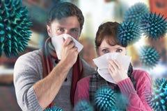 Image composée des nez de soufflement de couples dans des tissus Photographie stock libre de droits