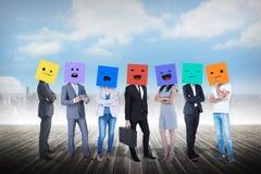 Image composée des personnes avec des boîtes sur leurs têtes Photos libres de droits