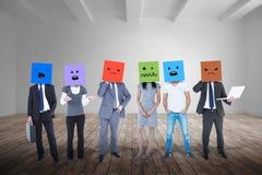 Image composée des personnes avec des boîtes sur leurs têtes Images stock