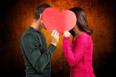 Image composée des visages de bâche de couples avec la forme de coeur Images libres de droits