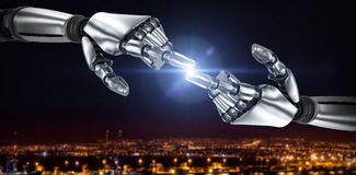 Image composée du bras argenté de robot dirigeant à quelque chose 3d Image stock