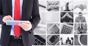 Image composée du défilement d'homme d'affaires sur son comprimé numérique image stock