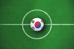 Image composée du football dans des couleurs de la Corée du Sud Images libres de droits