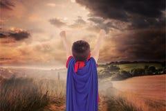 Image composée du garçon masqué feignant pour être super héros Images libres de droits