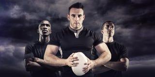 Image composée du joueur dur de rugby regardant l'appareil-photo Images stock