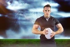 Image composée du joueur dur de rugby regardant l'appareil-photo 3D Photos libres de droits