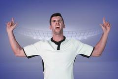 Image composée du joueur enthousiaste de rugby se dirigeant  photos stock