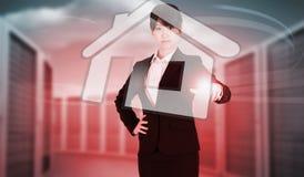 Image composée du pointage focalisé de femme d'affaires photographie stock libre de droits