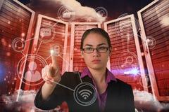 Image composée du pointage sérieux de femme d'affaires photographie stock libre de droits