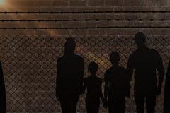 Image composée du portrait de la famille heureuse marchant au-dessus du fond blanc Images libres de droits