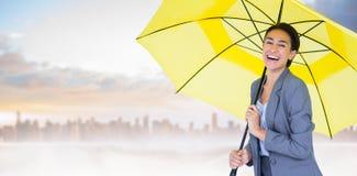 Image composée du portrait de la femme d'affaires heureuse tenant le parapluie Photos libres de droits