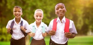 Image composée du portrait des étudiants heureux dans des uniformes photo stock