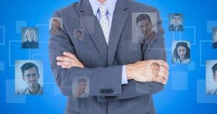 Image composée du portrait des bras debout de sourire d'homme d'affaires croisés photos stock