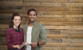 Image composée du portrait des personnes posant avec le comprimé numérique Photographie stock